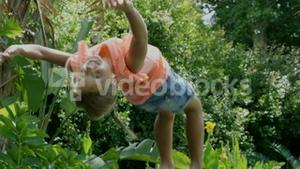Close up of girl doing back flip on the trampoline