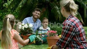 Family having a discussion while gardening together