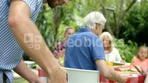 Happy family doing barbecue together