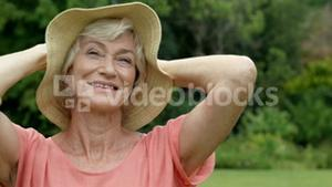 Happy senior woman posing alone