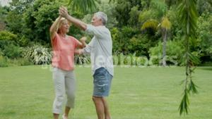 Mature couple dancing together