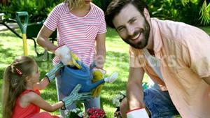 Portrait of father is smiling in front of his family during the gardening