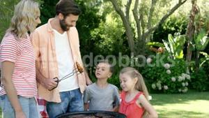 Happy family is preparing a barbecue in the garden