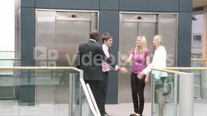 Business team shaking hands in a building