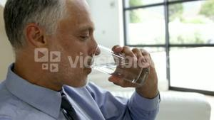 Man drinking water glass
