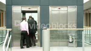 Business people using a lift in building