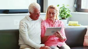 A senior couple using tablet computer