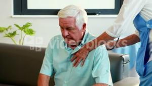 nurse listening to chest of patient with stethoscope
