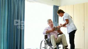Nurse giving tablet to his patient