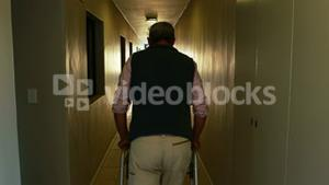 Patient walking with zimmer frame