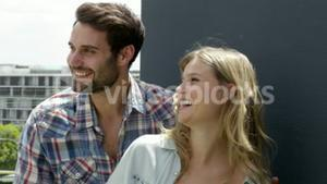 Cute couple laughing on the balcony