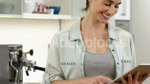 Smiling woman scrolling on her digital tablet
