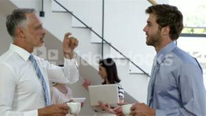 Businessman drinking a coffee together while businesswoman
