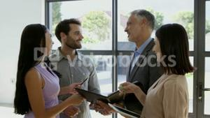 Couple signing the agreement to get their new house