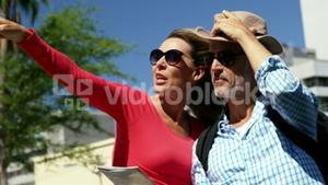 Mature couple is looking a map and pointing