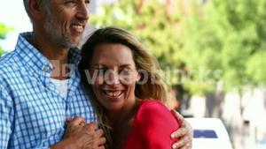 Portrait of mature couple is embracing and smiling