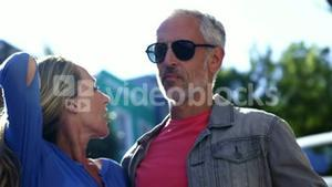 Portrait of mature couple is relaxing in the street