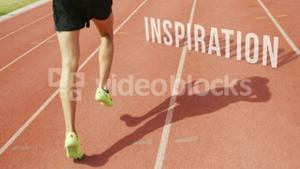 Athletic man running with the word inspiration on the floor