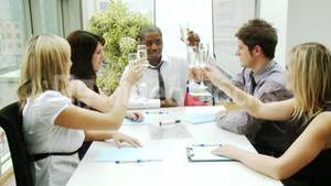 Business people celebrating a success with champagne