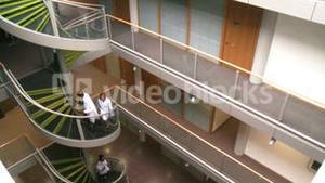 High angle of doctors going upstairs in a hospital
