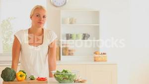 Woman eating slices of vegetables and fruit