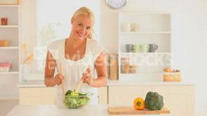 Woman preparing a salad for dinner