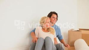 Couple enjoying being in their new livingroom