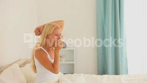 Gracious blonde woman getting up