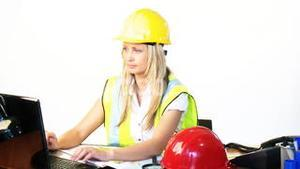 Blonde female architect working in office