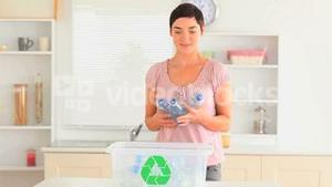 Woman recycling her waste