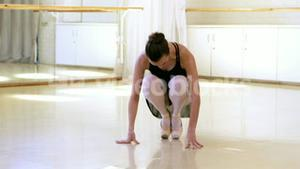 Portrait of a ballerina is preparing to dance