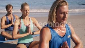 Three friends doing yoga