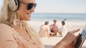 Woman lying on her deckchair with her tablet
