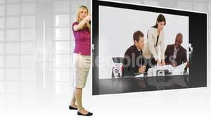 Woman standing before large TV screen