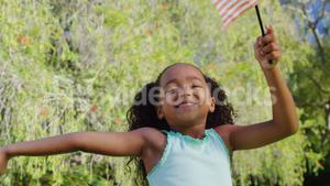 A child is playing with an american flag