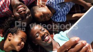 Family lying and taking a selfie