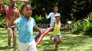 Family running with American flags