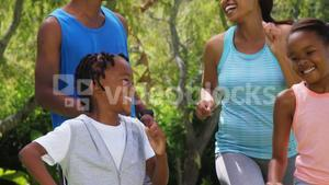 Family smiling and running