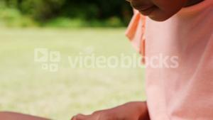 Close up of little girl using a tablet computer