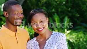 Portrait of cute couple posing and smiling