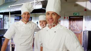 Portrait of chefs in commercial kitchen