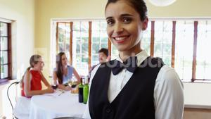Female waitress serving food to costumers