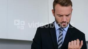 Businessman adjusting his cuff