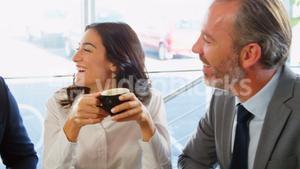 Smiling people drinking coffee and orange juice