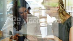 Two women watching a tablet