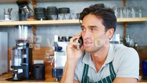 Young man talking mobile phone