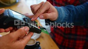 Customer paying by credit card in restaurant