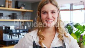 Waitress with hands on hips in restaurant