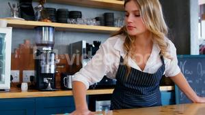 Waitress cleaning the counter