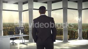 Rear view of businessman standing in office